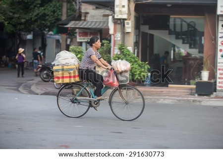 Hanoi , Vietnam - June 17; Life of Vietnamese June 17, 2015 . Goods vendor at street market in HANOI, VIETNAM