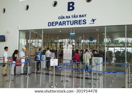 Hanoi, Vietnam - June 26, 2015: Line of people queue at departure gate at Noi Bai International Airport - stock photo