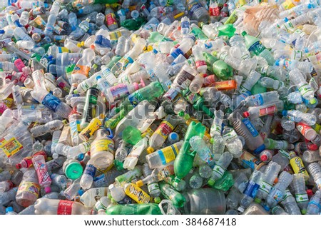 HANOI, VIETNAM-MAR 1, 2016: Close-up view plastic bottles of various drinks in the yard of a company specializing in ecological treatments. Large heap of plastic bottles and containers for recycling. - stock photo