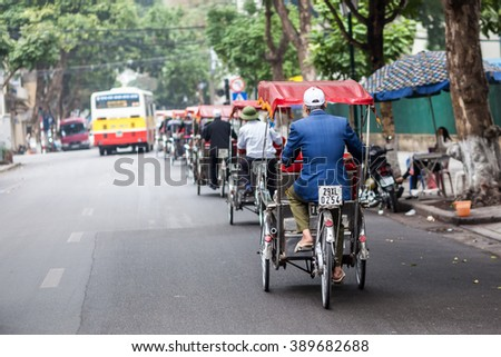 hanoi,vietnam, Mar 5, 2016: Life in vietnam- Cyclo beside Sword lake in hanoi, vietnam. Cyclo is the tourist's farvourite vehicle transportation in vietnam
