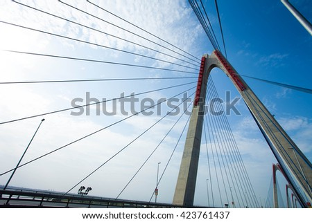 Hanoi, Vietnam - May 16, 2016: Nhat Tan bridge in the north of Hanoi. Cable-stayed bridge many spans the largest serial Vietnam. Long bridge is 9km, was put into operation from 2015.