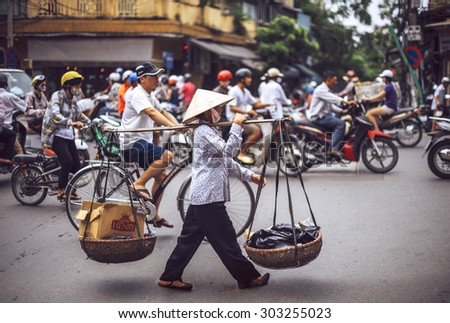 Hanoi, Vietnam - May 2, 2015: Vietnamese street market lady seller, on May 2, 2015, in Hanoi, Vietnam