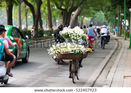 Hanoi, Vietnam - Nov 22, 2016: Life in Vietnam. An unidentified Street vendors. The Flower seller in streer of Hanoi.