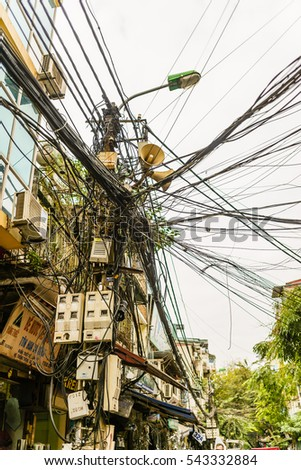 Hanoi, Vietnam - November 29, 2016: electricity post line electric danger energy engineering service power town in Hang Thiec street