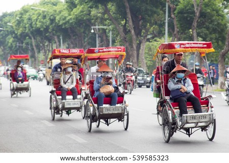 Hanoi, Vietnam, November 25 2016: Life in vietnam- Cyclo beside Sword lake in hanoi, vietnam. Cyclo is the tourist's farvourite vehicle transportation in vietnam