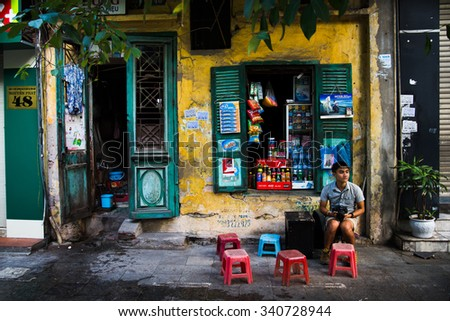 HANOI, VIETNAM - NOVEMBER 18, 2015: Unidentified street vendors in Hanoi ancient town, Vietnam.