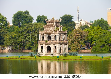 Hanoi, Vietnam -October 19, 2015: HoanKiem Lake, the little lake in the old part of Hanoi, Vietnam, with the Turtle Tower. Turtle Tower is the symbol of Hanoi,Vietnam. HoanKiem lake is center of Hanoi