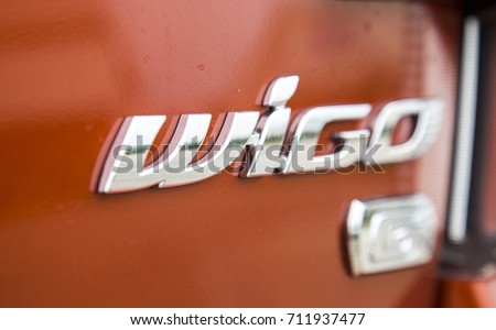 Hanoi, Vietnam - Sep 1, 2017: Close up of the logo of Toyota Wigo compact car, taken within a test drive. Toyota Motor is a Japanese automotive manufacturer headquartered in Toyota, Aichi, Japan.