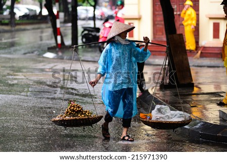 HANOI, VIETNAM - SEP 3: Unidentified street vendor on September 3, 2014 in Hanoi, Vietnam. This is a specific tradition in Hanoi
