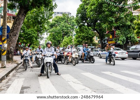 HANOI, VIETNAM - SEP 23, 2014: Unidentified Vietnamese people on a motorbike. 92% of Vietnamese people belong to the Viet ethnic group