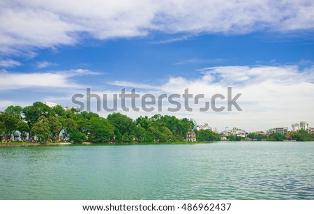 Hanoi, Vietnam - Sept 1, 2016: HoanKiem Lake, the little lake in the old part of Hanoi, Vietnam, with the Turtle Tower. Turtle Tower is the symbol of Hanoi,Vietnam. HoanKiem lake is center of Hanoi