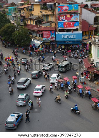 Hanoi, Vietnam - September 2, 2015: the central roundabout between Hoam Kiem Lake and the Old Quarter is a popular meeting point in Hanoi, Vietnam  - stock photo
