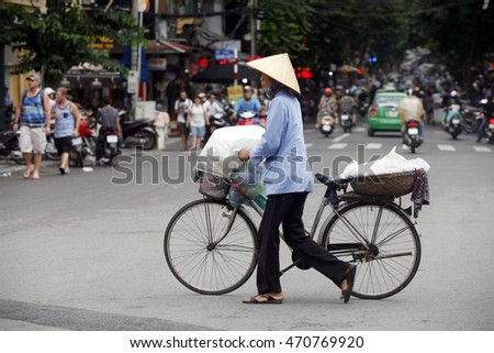 Hanoi, vietnam : Street vendors in Hanoi's Old Quarter on Aug 16, 2016, She sell tropical fruits and vegetable this is Vietnam's culture