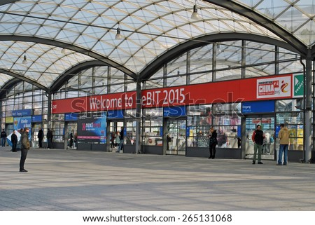 HANOVER, GERMANY, 20 MARCH 2015 - People waiting at the entrance of the Hannover Messe at the last day of CeBit, the biggest trade fair for information technology in the world. - stock photo
