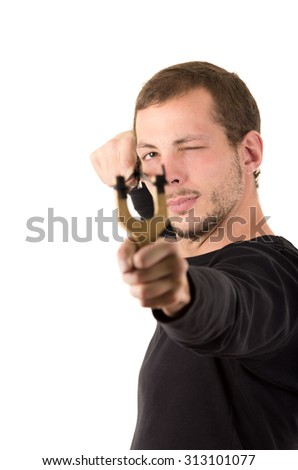 Hansome man concentrated aiming a slingshot isolated over white background.
