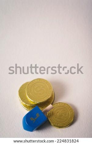 Hanukkah Dreidel And Chocolate Gelt Coins - stock photo