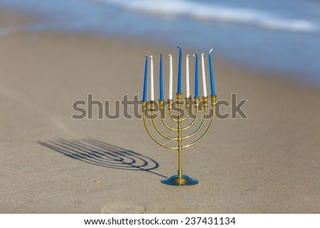 Hanukkah Menorah on the beach - stock photo