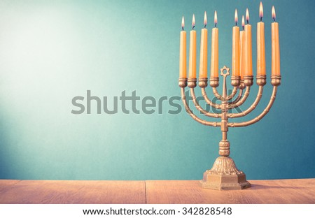 Hanukkah menorah with burning candles for holiday card background. Retro old style filtered photo - stock photo