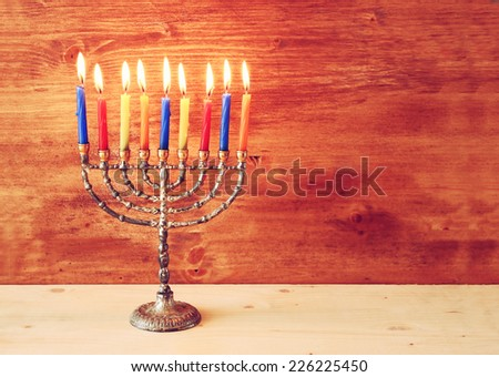 Hanukkah menorah with Burning candles. retro filtered image  - stock photo