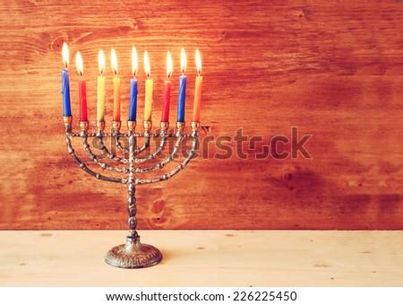 Hanukkah menorah with Burning candles. retro filtered image  - stock photo