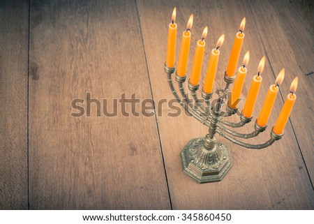 Hanukkah menorah with burning candles. Retro old style filtered photo - stock photo
