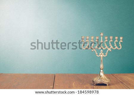 Hanukkah menorah without candles on wooden table - stock photo