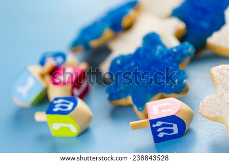 Hanukkah white and blue stars hand frosted sugar cookies, - stock photo