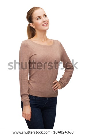 hapiness and people concept - happy smiling young woman dreaming - stock photo