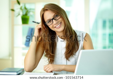 Happily smiling girl looking at camera - stock photo