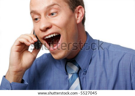 Happily surprised businessman talking on his mobile phone, against a white background. - stock photo