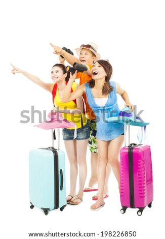 happily young backpackers raise hands to point the direction - stock photo