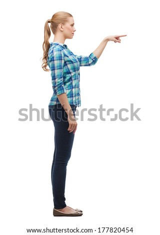 happiness, advertising and people concept - smiling young woman choosing something in the air - stock photo