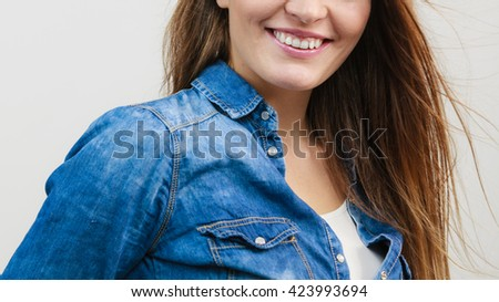 Happiness and joy. Smiling positive girl portrait. Charming joyful woman wearing fashionable stylish denim jeans clothes. - stock photo