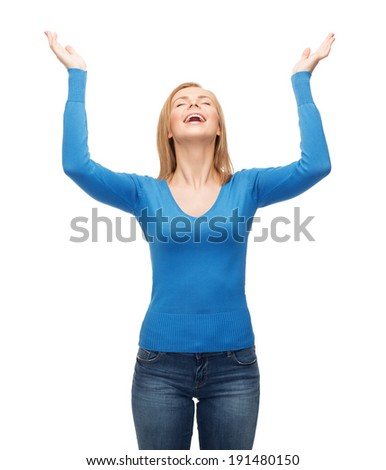 happiness and people concept - laughing young woman with closed eyes waving hands