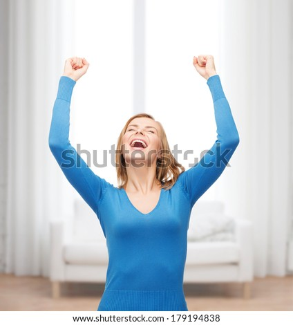 happiness and people concept - laughing young woman with hands up and closed eyes - stock photo