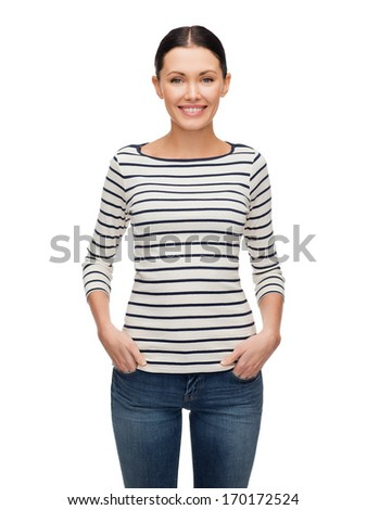 happiness and people concept - smiling girl in casual clothes - stock photo