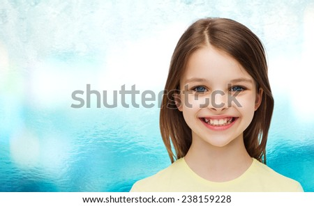 happiness and people concept - smiling little girl over white background - stock photo