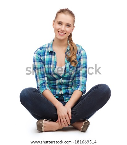 happiness and people concept - smiling young woman in casual clothes sitiing on floor - stock photo