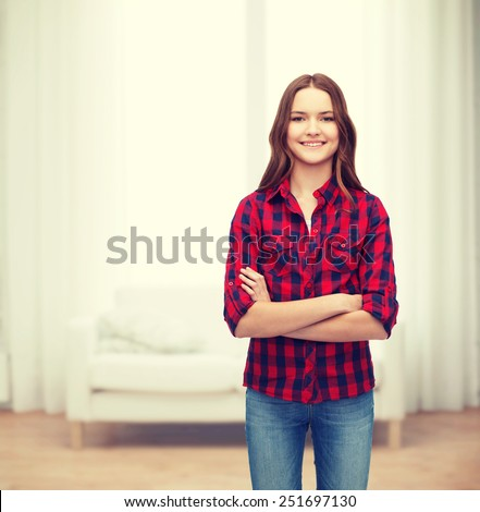 happiness and people concept - smiling young woman in casual clothes with crossed arms - stock photo