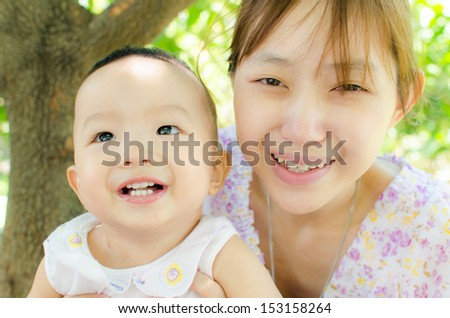 happiness baby and mom smile,family happy