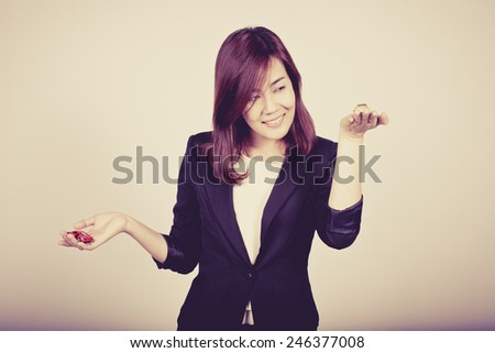 Happiness beautiful business woman with a toy car in her hand, process color - stock photo