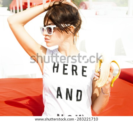 Happiness bliss freedom concept.Young stylish sexy pretty hipster girl having fun, and surprised. Funny image of man hand feeds with big banana blonde woman.Eating banana,health diet,banana fruit