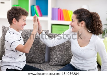 Happiness brother and sister have a deal - stock photo