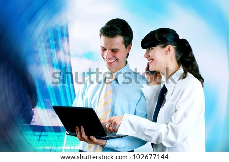 Happiness businessman and businesswoman on blur business architecture background - stock photo