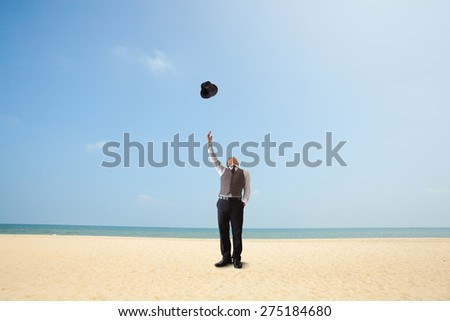 Happiness businessman on the beach. - stock photo