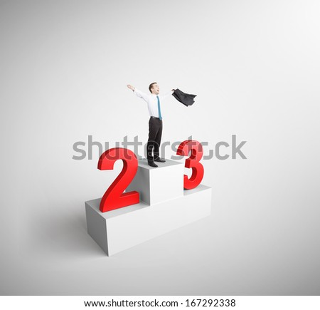 happiness businessman took first place on podium - stock photo
