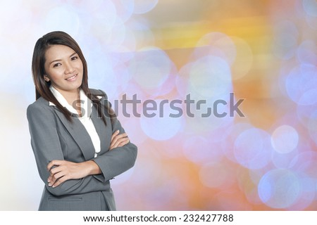 Happiness businesswoman on the business blur architecture background  - stock photo