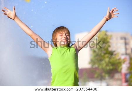 Happiness child relaxing outdoors - stock photo