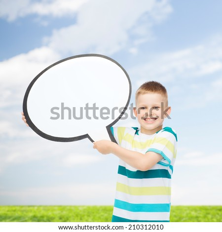 happiness, childhood, conversation, environment and people concept - smiling little boy with blank text bubble over natural background - stock photo
