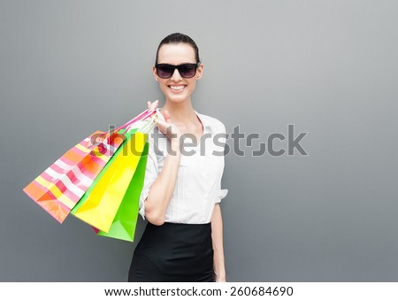 Happiness, consumerism, sale and people concept - Smiling young woman with shopping bags - stock photo